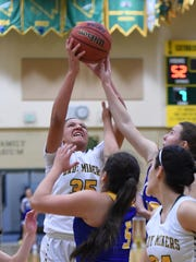Manogue's Amaya McLeod reaches for a rebound against
