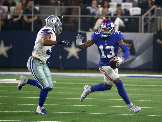 New York Giants wide receiver Odell Beckham (13) looks for room against Dallas Cowboys cornerback Byron Jones (31) during the first half of an NFL football game in Arlington, Texas, Sunday, Sept. 16, 2018. (AP Photo/Michael Ainsworth)