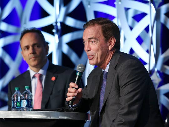 Then-Braidy Industries CEO Craig Bouchard, right, addressed the crowd as former Gov. Matt Bevin looked on during the Governor's Local Issues Luncheon at the Galt House in Louisville on Aug. 24, 2017.