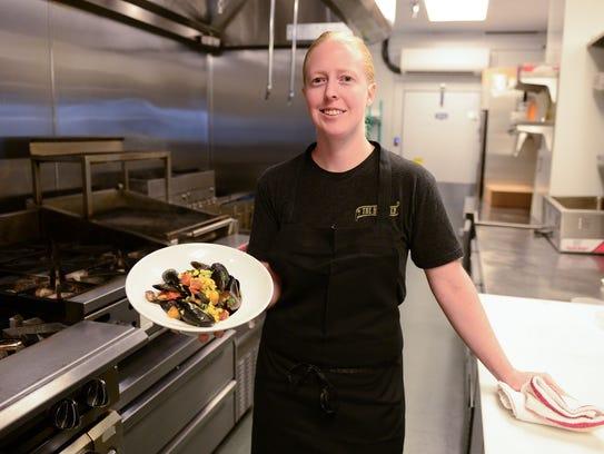Julia Robinson, Chef de cuisine at The Blue Hen, prepares