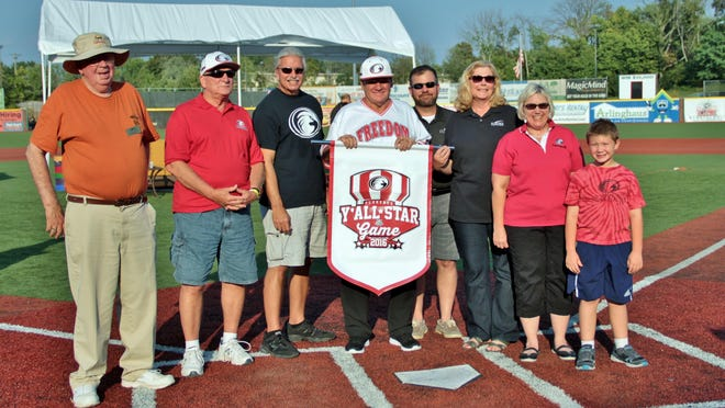 Florence City Council members including David Osborne, Mel Carroll, Gary Winn, Kelly Huff, Florence Mayor Diane Whalen, and Julie Metzger Aubuchon, with her son, Brady, stand with Pete Rose at the Florence Freedom game on Sept. 3.
