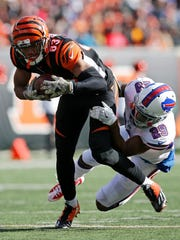 Cincinnati Bengals wide receiver Tyler Boyd (83) fights off a tackle on a catch over the middle in the first quarter of the NFL Week 11 game between the Cincinnati Bengals and the Buffalo Bills at Paul Brown Stadium in Cincinnati on Sunday, Nov. 20, 2016. At halftime the Bengals led 12-10.