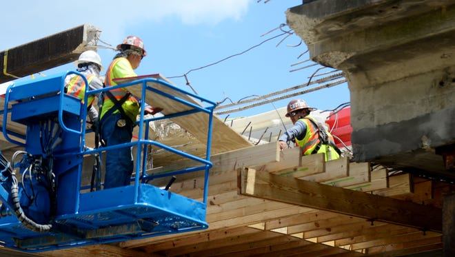 Key, LLC, construction workers repair the I-59 overpass. MDOT officials expect the repair to be completed by Aug. 26.