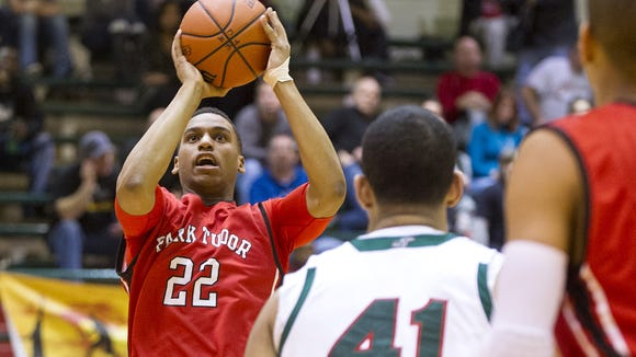 Park Tudor High School senior Trevon Bluiett (22) puts up a shot in the first half of boys varsity basketball action of the Indy Legacy Basketball Showcase Saturday, Jan. 4, 2014, at Arsenal Technical High School.