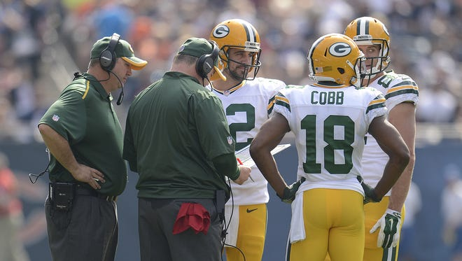 Green Bay Packers quarterback Aaron Rodgers talks with head coach Mike McCarthy and his receivers during a time out in Sunday's game at Soldier Field in Chicago. Evan Siegle/Press-Gazette Media/@PGevansiegle