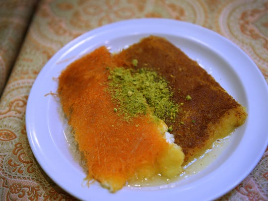 A plate of Kenafeh is seen on the table at Al Basha