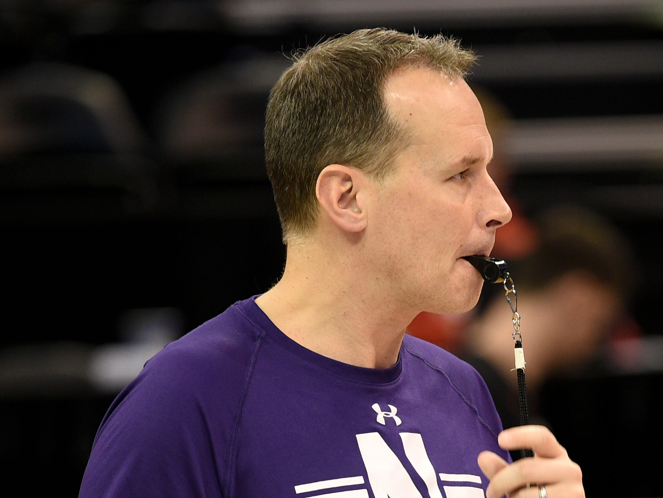 Northwestern coach Chris Collins watches practice Wednesday at Vivint Smart Home Arena.