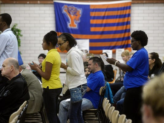 Teachers, parents and students line up to comment during a school board meeting in October.