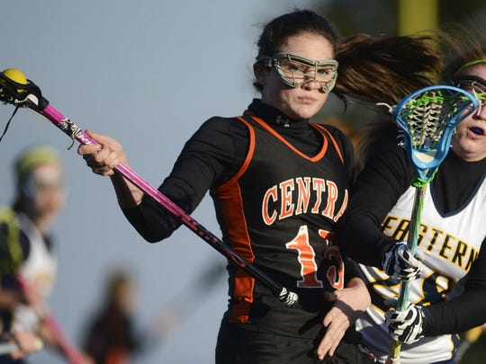 Eastern York's Briana Pfeiffer tries to get the ball from Central York's Hannah Gilhool during the girls' lacrosse match in March at Eastern. (KATE PENN -- GAMETIMEPA.COM)
