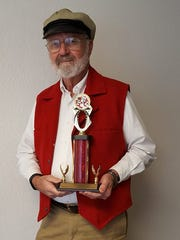 John J. Beck shows his trophy for earning third place in the Neighbor to Neighbor Rib Fest contest.
