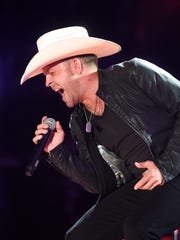 Justin Moore performs at the 2016 CMA Music Festival. In the wake of the Las Vegas shooting, Moore hired a security guard for the first time in his career.