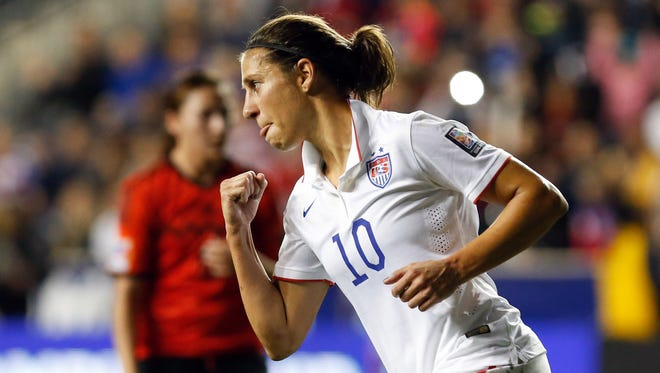 United States midfielder Carli Lloyd (10) reacts after scoring against Mexico on a penalty kick during the first half of a women's World Cup Qualifier semifinal soccer match at PPL Park.