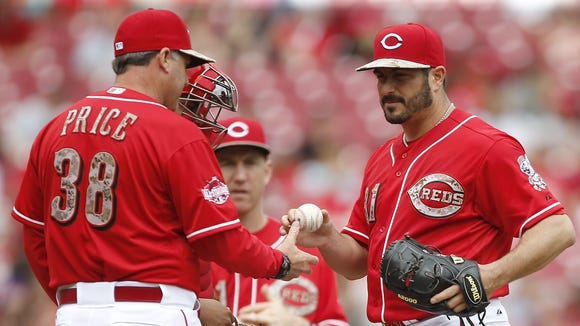 Bryan Price pulls Reds starting pitcher Jason Marquis out of the game in the sixth inning.