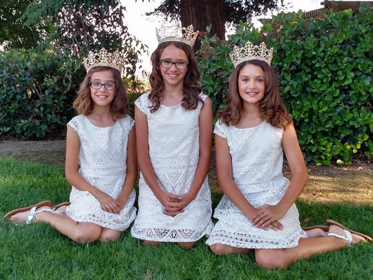 Visalia Holy Ghost Junior Queen Brianna Santos, center, and her attendants, her sister Alexis Santos, left, and Sydney Nunes.