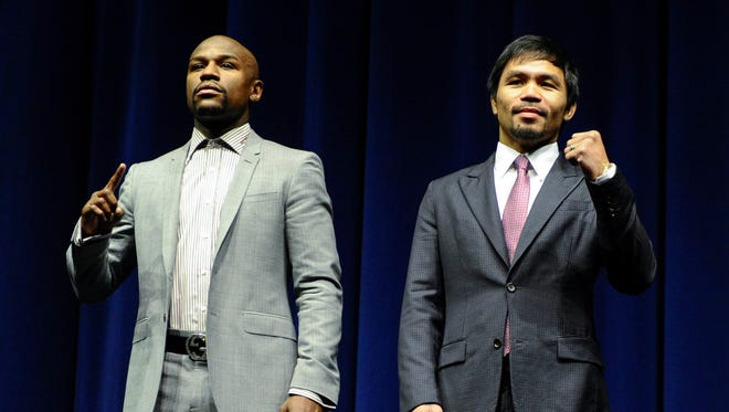 Floyd Mayweather, left, according to  Manny Pacquiao's camp, rejected Pacquiao's offer of a $5 million penalty clause if either fighter failed a drug test before or after their May 2 mega-fight.