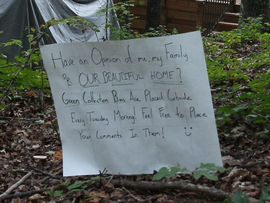 Handwritten signs were put up after a neighbor complained