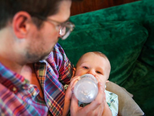 Travis Harris feeds his son, Bly, on Monday, June 11,