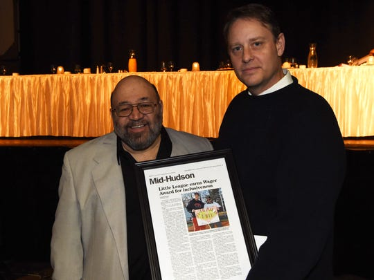 Peter McGowan, right, president of the Town of Wappinger Little League, stands with Mike Briccetti, left, vice president of the Challenger League, at the 26th Annual Martin Luther King Jr. Breakfast at the Mid-Hudson Civic Center in the City of Poughkeepsie. The Town of Wappinger Little League received the Richard K. Wager Inclusive Champion Award.