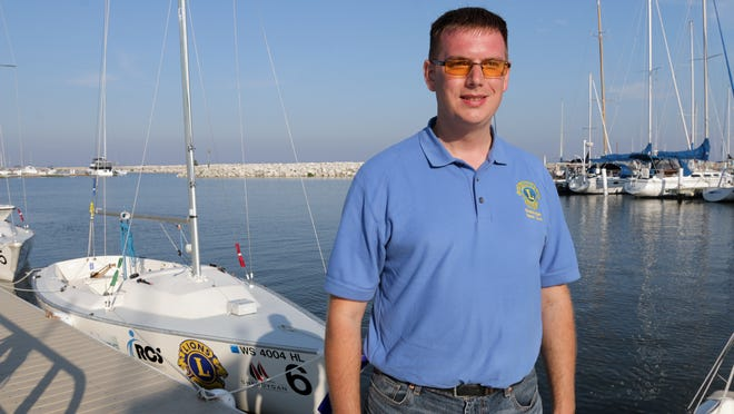 BJ Blahnik of Sheboygan is legally blind but has taken up the sport of sailing with help from local sailors.