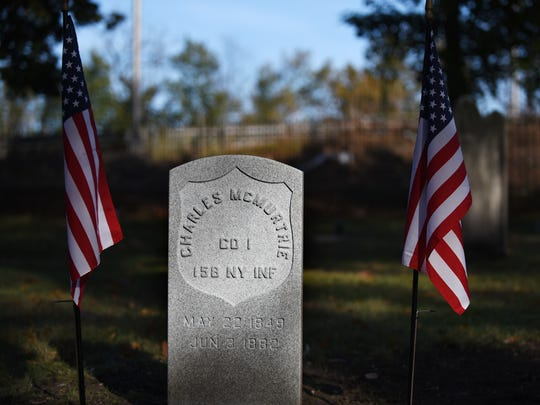 A memorial service at Cedar Lawn Cemetery in Paterson on Saturday November 11, 2017. The service is held as a marker is put on the grave of Charles McMurtrie, a Civil War veteran from Paterson who died in the 1880s and whose grave had been unmarked until his great great granddaughter, Maureen Clary of SC, tracked down his existence and history.
