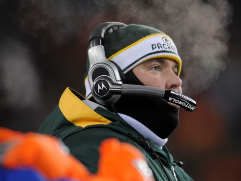 Green Bay head coach Mike McCarthy was bundled up for the NFC Championship game on Jan. 20, 2008 when the Packers lost to the Giants. On Sunday, the weather could be even colder at Lambeau Field.