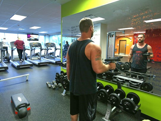 John Hazel of United Shore Financial Services takes advantage of the gym at the Troy headquarters of the company.