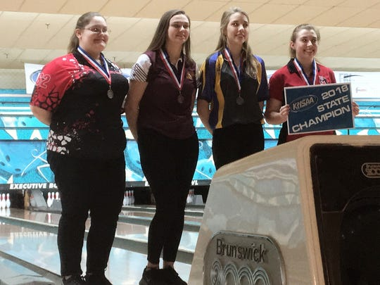 Sierra Brandt of Cooper, second from left, finished third, and Kaylee Hitt of Campbell County, third from left, finished second during the KHSAA state singles bowling tournament Feb. 8, 2018 at Executive Strikes & Spares, Louisville, KY.