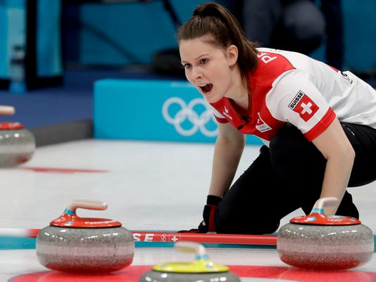 Switzerland Jenny Perret makes a call during a mixed double curling match against China's Wang Rui and Ba Dexin at the 2018 Winter Olympics in Gangneung, South Korea, Thursday, Feb. 8, 2018. (AP Photo/Natacha Pisarenko)