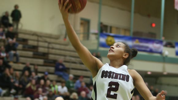 Ossining's Andra Espinoza-Hunter (2) drives to the basket against Our Lady of Mercy during the girls Class AA state semifinal  game at Hudson Valley Community College in Troy March 17, 2017.