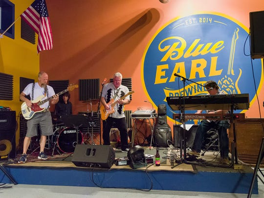 Smyrna's Blue Earl Brewing Company owner Ronnie Price (left) jams with the Blue Cat Blues band performing in The Juke at brewery on Saturday.