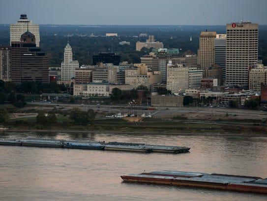 Barges pass each other in front of Downtown Memphis