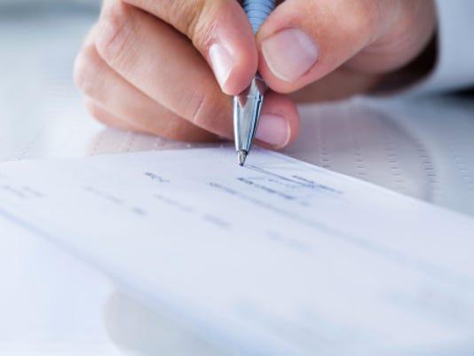 Check writing Stock Image