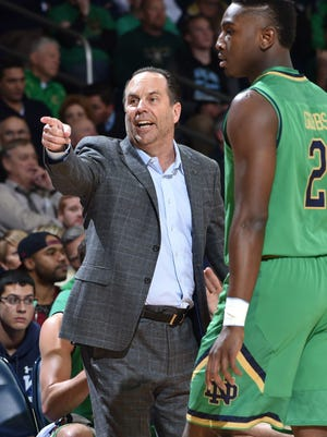 Notre Dame Fighting Irish head coach Mike Brey signals to his players in the first half against the Iowa Hawkeyes at the Purcell Pavilion.