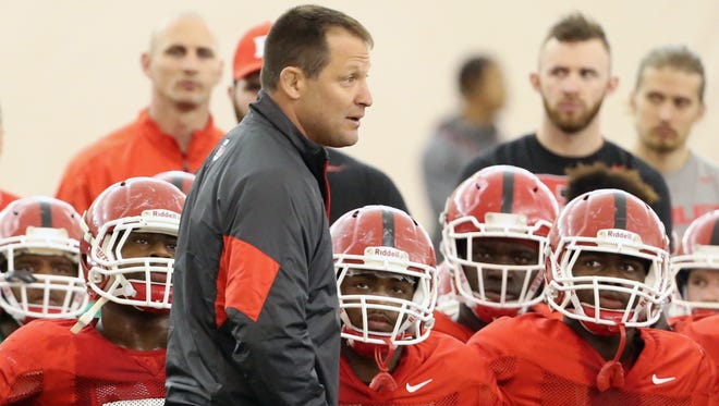 Rutgers football players resume their Spring practice sessions at the practice bubble on the Piscataway Campus on Thursday April 7, 2016Rutgers mens wrestling head coach Scott Goodale  addresses the football before practice.
