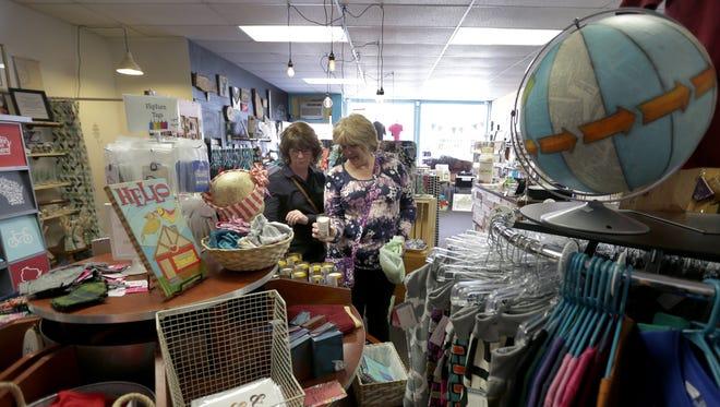 Connie Zimmerman, left, and Cindy Hegglund shop at Blue Moon Emporium  Appleton.