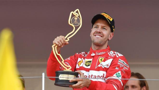 Sebastian Vettel holds his trophy after winning the Monaco Grand Prix Sunday.
