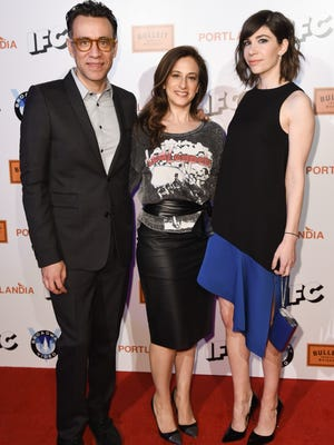 Fred Armisen, left, Jennifer Caserta and Carrie Brownstein, right, arrive at Portlandia Season 5 Premiere.