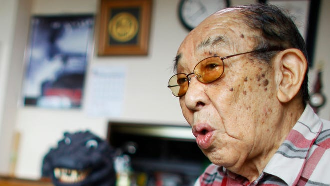 In this April 28, 2014 photo, original Godzilla actor Haruo Nakajima speaks during an interview at his home in Sagamihara, near Tokyo. Nakajima, the actor who stomped in a rubber suit to portray the original 1954 Godzilla, died on Monday, Aug. 7, 2017. He was 88.