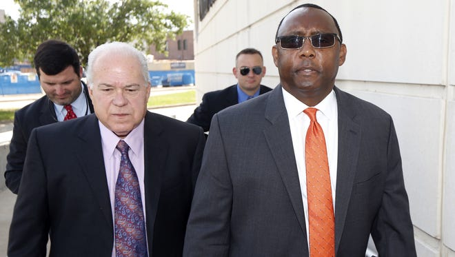 Former Mississippi Corrections Commissioner Chris Epps, right, walks to the federal courthouse.