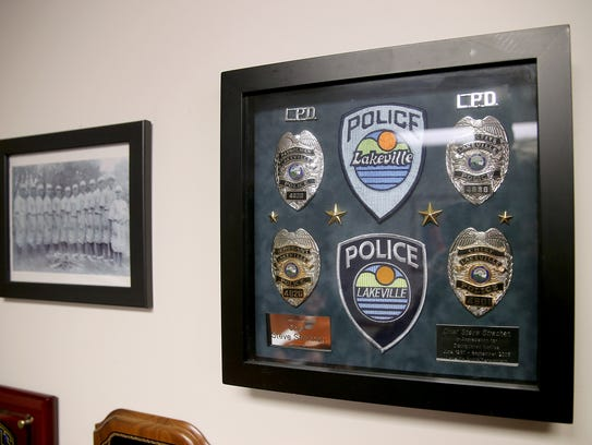 On the wall in Bremerton Police Chief Steve Strachan's office are badges from his time as an officer in Lakeville, Minnesota.
