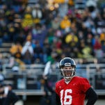 Iowa quarterback C.J. Beathard (16) awaits the next play as fans gather in the stands Friday, April 8, 2016, during the Haweye's open practice at Valley Stadium in West Des Moines.