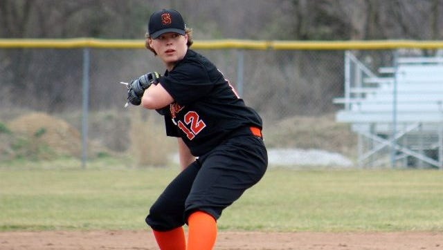 Stockbridge freshman pitcher Carson Robinson delivers a pitch during a game this spring. Despite being born without a left hand, Robinson has thrived in sports.
