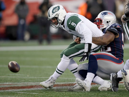 New England Patriots linebacker James Harrison, right, sacks New York Jets quarterback Bryce Petty during the second half of an NFL football game, Sunday, Dec. 31, 2017, in Foxborough, Mass.