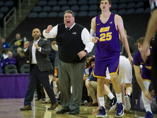University of Evansville's  Head Coach Marty Simmons yells at his players from the bench in the first half at the Ford Center on Wednesday, Jan. 31, 2018.