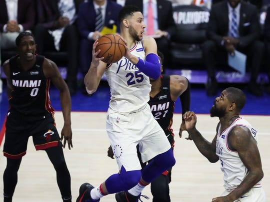 Sixer Ben Simmons grabs rebound in front of teammate Amir Johnson in the first half of the Sixers' 130-103 win in the opening game of the first round of the NBA playoffs at the Wells Fargo Center Saturday.