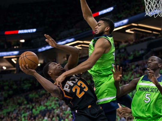 Timberwolves center Karl-Anthony Towns fouls Suns forward Danuel House (23) on Saturday.
