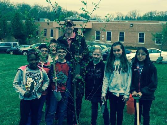The Bayberry School 4th Grade Garden Club planted a tree to honor Arbor Day. Left to right are: Destiny Watson, Aryan Anand, Eliaz Michel, Sebastian Sopko, Mr. George Sopko, Arkin Navani, Amanda Mattiassi, Emily Grigonis, and Emily Samiengo.