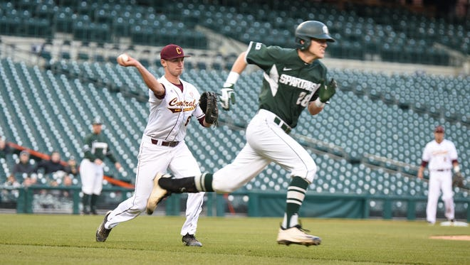 Central Michigan first baseman Alex Borglin throws out Michigan State's Matt Byars Wednesday at Comerica Park.