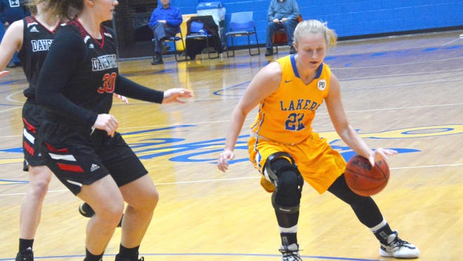 Lake Superior State's Sadie DeWildt (22) handles the ball during a home game against Davenport last season. The Lakers will be at home against Northern Michigan this Saturday at Sunday at the Bud Cooper Gym.