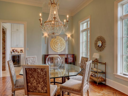 The formal dining room is open and full of light.
